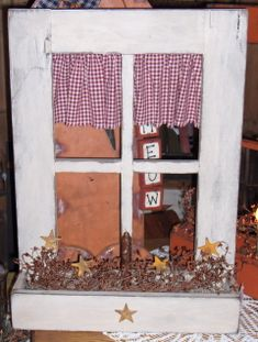 Curtains on back side of window .. Neat idea