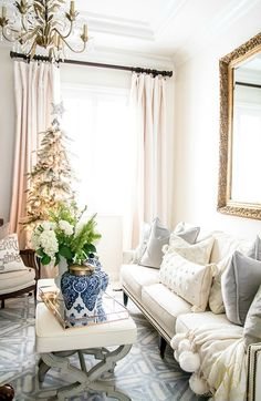 Christmas Home Tour 2017 - Silver and Gold Christmas in the home office! a pom pom throw blanket, blue and white ginger jars, and a flocked tree make the season bright! - Randi Garrett Design