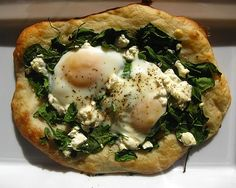 sauteed spinach, goat cheese pizza with over easy eggs...