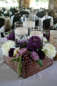25 Simple and Cute Rustic Wooden Box Centerpiece Ideas to Liven Up Your Decor - Purple wedding centerpieces, Unique wedding centerpieces, Wedding decorations, Amazing wedding centerpieces, Rustic wedd - Rustic Table Centerpieces, Wooden Box Centerpiece, Unique Wedding Centerpieces, Unique Weddings, Table Decorations, Centerpiece Ideas, Purple Wedding Decorations, Rustic Weddings, Wedding Rustic