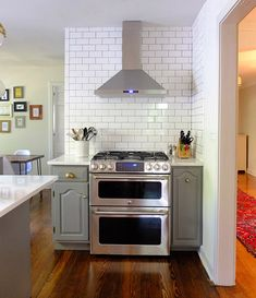 subway tile all the way up! shannon_tate_kitchen_16 via design*sponge