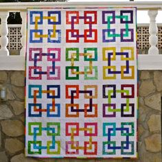 This is so bright and so well pieced! BOXING RINGS QUILT PATTERN from Sew Happy Me.