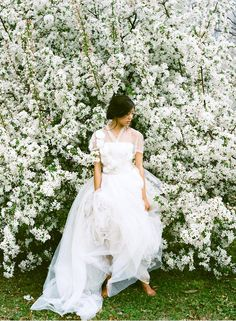 WEDDING THEME: Sakura / Cherry Blossoms. COLORS: Soft pastels of white, peach / pink, green and gold. STYLE: Romantic, vintage, nature. MONEY SAVING TIP: Romantic cherry blossoms is the perfect backdrop for a photoshoot. Save on the floral budget!