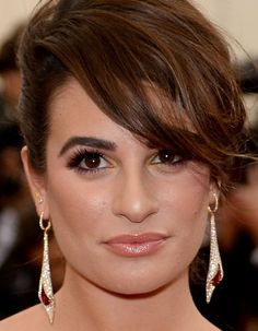 Lea Michele's voluminous updo and all-over-bronze makeup