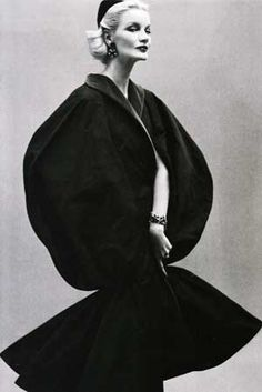 Sunny Harnett, in a 1954 photograph by Richard Avedon. Cape by Jean Desses.