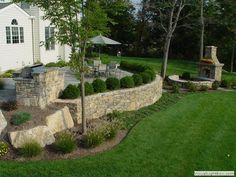 Raised Concrete Patio Design Ideas | Raised patio with outdoor kitchen and fireplace in New Jersey Raised ...