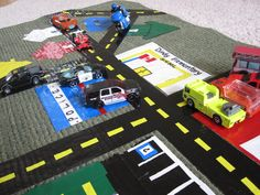 For the kid who loves to drive around town - make your own special roadway with a ktichen mat!