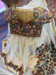 Kalamkari patch work on the saree with a kalamkari blouse