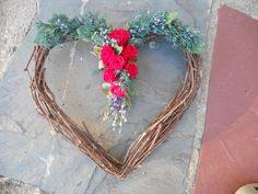 Heart grapevine wreath with red roses and greens...