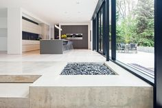 Cutting edge family home in South West Oakville, designed by Guido Costantino Architect, Interior - living area with kitchen.