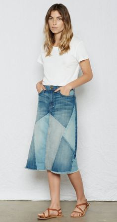 the patchwork skirt - this reworked denim skirt in varying shades of denim patchwork sits low on the hips and features calf grazing, midi length and frayed edge. pair with a vintage tee and sandals and wear on vacation.