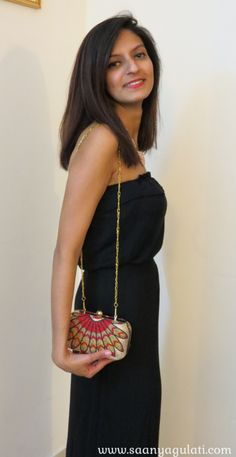 Tarini Nirula's occasion wear bags - the Red Phoenix Minaudiere can be carried like a clutch or a sling bag