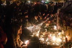 Attacks in Central Paris - People left flowers and lit candles at Place de la République in Paris. - The New York Times