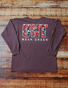 Staying trendy on game day is a big deal. Stay trendy while showing your school spirit in this fantastically cute long sleeve University of North Texas Mean Green t-shirt Go UNT Cheer Shirts, Football Shirts, College Life, College Football, University Of North Texas, Texas Shirts, Dorm Stuff, Mean Green, School School