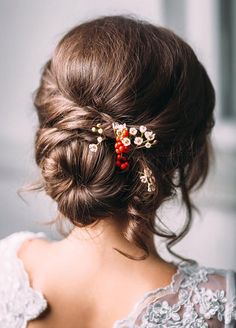 Unusual accessories, like a bundle of berries, make a classic chignon stand apart. Wedding Hairstyles, Wedding Hairstyles for Long Hair, Bridal Beauty, Bridal Hairstyles