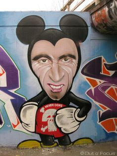Graffiti satire appropriating the famous Micky Mouse cartoon character.
