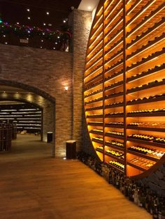 Fantastic Wine wall with thin veneer stone. Great way to add interest in a commercial or residential space. Wine Cellar Design, Wine Design, Wine Shelves, Wine Storage, Caves, Home Wine Cellars, Drink Bar, Wine Display, Wine Wall