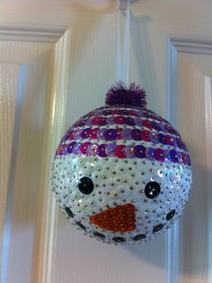 My first snowman with a hat ornament. Wish I could have found bigger sparkly poms for the hat