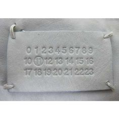 Martin Margiela Label. All garments for all collections (Mens, Womens, Diffusion) have a label with rows of numbers. The specific collection number is circled.