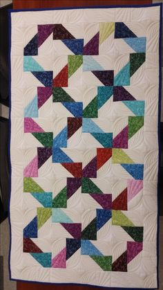 Scrappy geometric quilt