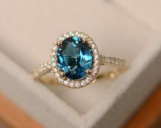 Items similar to London blue topaz ring, yellow gold ring, halo engagement ring, gold on Etsy Halo Engagement Rings, Diamond Wedding Rings, Halo Rings, Diamond Rings, Ring Verlobung, London Blue Topaz, Blue Topaz Ring, Yellow Gold Rings, Rose Gold
