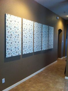 My BFF and I covered canvas with fabric to create a sound dampening art project for a large wall in my home.