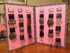 DIY Cheap Jewelry Display. Foam Board at Dollar Tree $1. Cut in half. Duct Tape from Dollar Tree $1. Taped edges and both boards together. Plastic hanging strips Free from Dollar Tree!