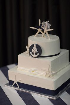 Starfish and anchors and cake, oh my! A sweet and beautiful cake for your Cape Cod beach wedding. www.thecasualgourmet.com