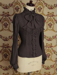 I love this blouse for it's elegant, refined, antique style.