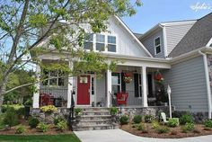 This is what I want if i won the mega millions - Farmhouse Style Front Porch With Pops of Red