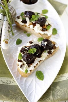 Crostini, the Italian bread appetizer, can hold anything your heart desires. Ricotta topped with figs cooked in liquor makes a tasty topping.
