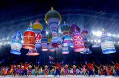 Dancers perform among large helium inflatables creating the elements of St. Basil's cathedral during the Opening Ceremony of the Sochi 2014 Olympic Games. (HOW HWEE YOUNG/EPA) #