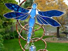 The wings of this dragonfly are made with blue hammered glass.  -  craftjuice.com