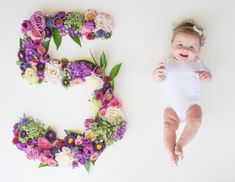 Baby monthly pictures. Fresh flowers. Baby girl. Five months.