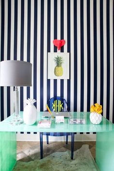 a striped wall makes this room look chic and fierce.