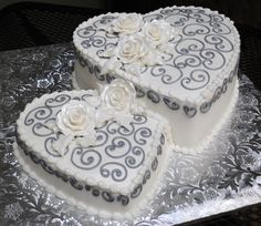 Tons of gorgeous cakes on this site!  I like the idea of interlocking hearts like these, both built upwards like 2 separate cakes merging into one.