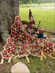 Beautiful afghan with woven motifs reminiscent of Celtic traditions.