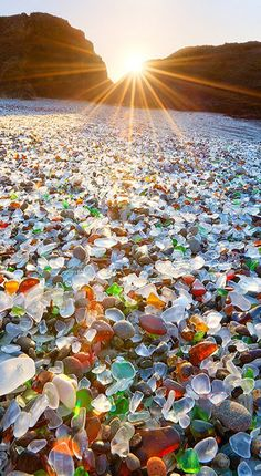 Glass Beach is a beach in MacKerricher State Park near Fort Bragg, California that is abundant in sea glass created from years of dumping garbage into an area of coastline near the northern part of the town. In the early 20th century | cynthia reccord