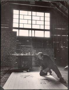 Martha Holmes portrait of Jackson Pollock in his studio painting, 1949.