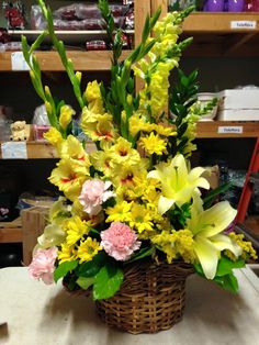 Bring a little fun and sunshine into your home with this gorgeous yellow floral arrangement with hints of pink.