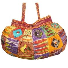The bag has dreadlock handles. It has razor cut and hardware. It is a patchwork bag with appliqués. It is also a bag with pleats at the top. The main compartment has both the zipper and the closing button. There is an interior zip pocket as well. The bag has stunning design.