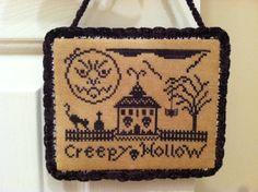 Stitcheree!  Free pattern here: http://stitcheree.blogspot.ca/2012/08/creepy-hollow-free-cross-stitch-pattern.html