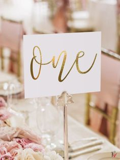 gold calligraphy wedding table numbers // handwriting in calligraphy ...