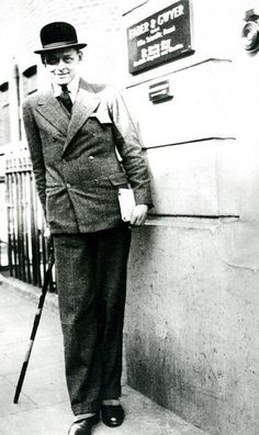 T. S. Eliot outside the Faber premises, 24 Russell Square