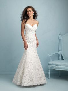Allure Bridal  9216  Gorgeous structured satin creates a flawless silhouette, while delicate beaded appliqués trail across the skirt.  Colors:  White/Silver, Ivory/Silver, Cafe/Ivory/Silver   Fabric:  Satin and Lace   Size:  2 - 32