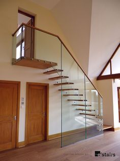 Floating timber treads supported by large glass panels.
