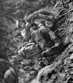 A French soldier and a German soldier in the same trench, no longer fighting.