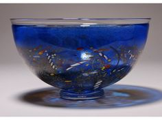 "The Kosta Boda blue and multicolored art glass bowl. Signed Kosta Boda #59252. Measures 5"" high x 8 ¼"" in diameter / 100/200"