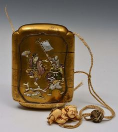 A THREE CASE JAPANESE LACQUER INRO decorated with floral mons in hiramakie on and around two decorative kinji panels within a silver frame richly decorated in Shibayama with the legend of Momotaro with monkey and pheasant companions, all dressed as Samurai and dancing to the success of bating the Ogre King and making off with his treasure,the pennant marked Nihon Ichi ,reverse with crane and falcon flying amidst flowers and shrubs, late Meiji, with ivory netsuke, 12cm