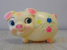 This is the cutest little vintage piggy bank ever!  It would look adorable in a baby or kids room